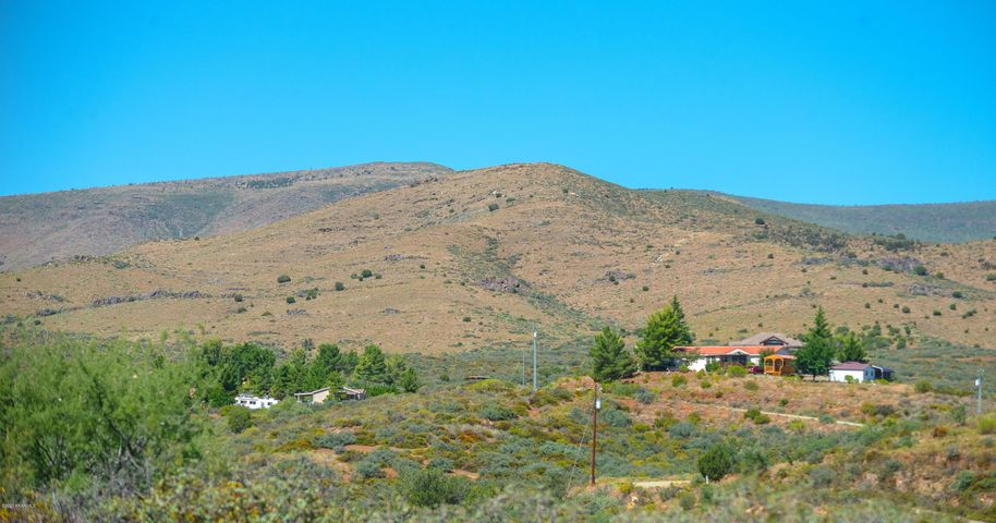 Big open 5-acre lot with ability to be split in less than 1-acre lots! Zoning also allows for site-built or manufactured and farm animals and horses depending on lot size. Enjoy beautiful views of the surrounding mountains and valleys. Mature natural landscaping including manzanita covers this almost flat lot. APS has a $10,000 credit for new service and expects this to fall under that when adding service to the property. Schedule a showing to check out this great opportunity while you can!