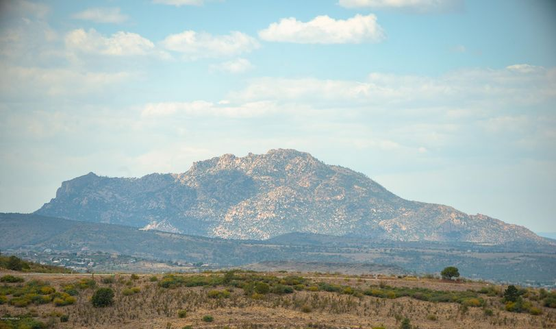 Stunning Yavapai Hills lot with incredible views! Build your custom home in one of Prescott's most desirable subdivisions. Behind this lot is open area of HOA land for added privacy and endless views of Granite Mountain. Builder plans are available for this lot. Seller is a home builder and will also offer a builder package if interested. Subdivision amenities include swimming pool, tennis and pickle ball courts, playground and clubhouse. Close to shopping and minutes to downtown square. Drive by and check out this amazing lot today while it is still available.
