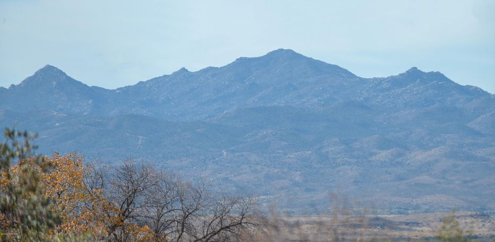 Fantastic views of the Mountains and the National forest!  This great piece of land is level, and the possibilities are endless!!  Build your dream home!  This land has high desert vegetation that is a true beauty. Surrounded by mountains, this property is located near Prescott so you can enjoy the benefits of living in the country with city conveniences close by! Come and enjoy the North Central Arizona Mountain lifestyle! See the lot while you still can!