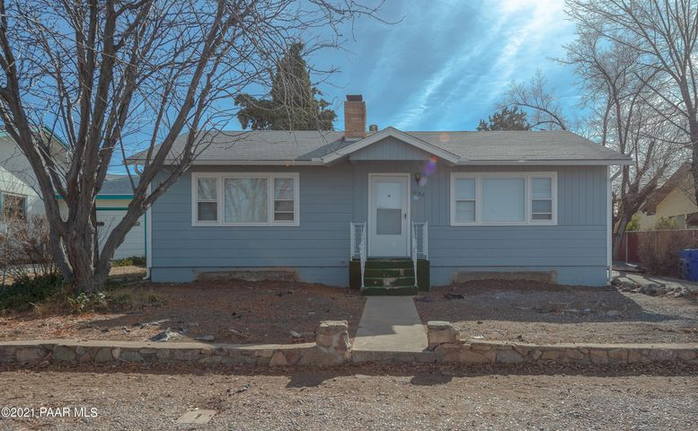 Adorable home close to shopping, restaurants, and the amazing downtown Prescott! This wonderful home features wood laminate floors throughout the whole house including the bathroom. The living room has a beautiful brick fireplace and bright open windows. The kitchen appliances are stainless-steel, it has new cabinets and great counter tops. This home is a 2 bedroom both with great sized closets and big open windows for lots of sunshine! A full bathroom with Shower and tub.  Detached garage with lots of storage.  Exceptionally large back yard with a flagstone patio partially covered. Landscaping on this one is easy to maintain along with a fully fenced back yard. This beautiful home is in a great location and has great views. Call us today... you don't want to miss this one!!