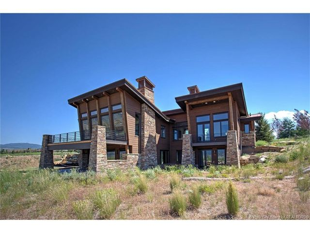 This new construction mountain contemporary estate was designed with the outdoors in mind to capitalize on the panoramic views of Park Citys three world-class ski resorts. The vaulted ceiling, oversized windows & la cantina sliding wall facilitate the ultimate in peaceful mountain relaxation. Features include chefs kitchen, thoughtful open floor plan, main level living, oversized windows for abundant light, and an extensive theatre with wet bar and lower level walk out designed for year round entertaining. Situated in Promontory, this private gated golf club and residential community features 2 world-class golf courses, spa, workout facilities, kids cabin, multiple pools, outfitters cabin and equestrian facilities, several clubhouses, five restaurants, and its new addition, the Promontory Beach House. This home is a must see for the ultimate in luxury and amenities. Comes with a fully Sponsored Golf Membership included in the price.