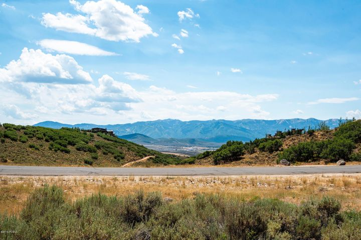 This lot has tremendous views of the mountains and is easy to build on! Build up to an 8,000 Square Foot home on this 1 Acre lot. Here is an opportunity to own a greatly at a below market price. A separate Promontory Membership is required for the use of Promontory's amenities.