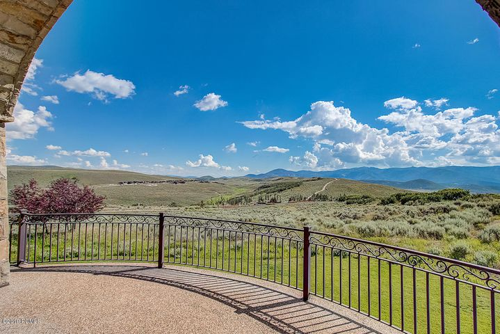 This elegant Tuscan-inspired home is perfect for entertaining with a spacious gourmet kitchen with two islands, an open floor plan, and gorgeous outdoor areas with incredible views of Park City's ski resorts and the nearby Nicklaus golf course. This home features high-end appliances and finishes, radiant heat, a large 6+ car heated garage, outdoor entertaining and living spaces stubbed for gas, and an integrated audio system. The downstairs makes any extended hosting a breeze with 4 bedrooms, built in bunks, living space, and a second kitchen. You can find additional entertainment options in the home's theater room and indoor sports court. The expansive main level master suite provides a luxurious retreat and features a private balcony with stunning views, two fireplaces, soaking tub, and steam shower. This home is a must-see!