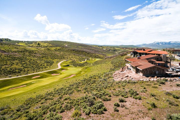 Build your dream home with the best golf views in Promontory. This elevated homesite sits above Hole #15 on the Pete Dye Golf course at Promontory, and has views up a protected canyon to several other holes of the golf course. It also has panoramic ski mountain views, which makes it one of the most desirable locations in Promontory, a Park City community with amenities including Pete Dye and Jack Nicklaus signature golf courses, fitness centers, spa, pools, a beach club, and the Shed. Seller also has completed house plans that may be included. Membership in the club is available by a separate transaction.