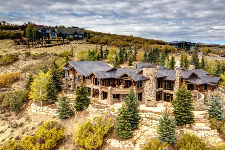 Finding the perfect balance of being located near world calls amenities, yet being in a private location to get away from it all is not an easy find. This unique and magnificent Mike Upwall designed home is located on a private lot where you can enjoy panoramic mountain views to truly unwind from the world, however it is within minutes from the family club amenities of the prestigious Promontory Club. This wonderful home has amenities to be enjoyed by your entire family and friends, and the amazing quality will be appreciated by everyone. In addition to the great room, kitchen and dining the main level features a large master suite, guest master, two offices and tremendous garage with parking for up to 8 cars. The home also features a national award winning movie theatre, separate girls & boys Cabins bunk rooms, Childs playhouse/room and large family room. Great outdoor entertaining spaces include 3000 square foot patio, horseshoe pit, grass play yard and tubing/sledding area.
