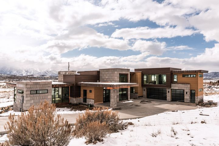 This home stands at the rarefied point where form meets function. This is art. Sited on Dakota Trail with unspoiled panoramic views of the Park City ski runs and mountains. This Upwall designed 5 bedrooms 7 baths architectural vision is aesthetically appealing at every turn. Large retracting glass panel walls dominate the grand living room, kitchen, main level grand master. The second grand master enjoys a spa-like sanctuary on own private level. The garden level is replete with an additional living room, well-appointed bar, 3 master-like guest rooms, 1200sq ft covered patio. There is an additional 1400 sq ft of decks for exceptional outdoor living and entertaining. Large finished bonus space for a future home gym, theater or storage. Designer finishes, fixtures and aesthetic. Come curate a lifestyle of rare pedigree in this architectural masterpiece. Please see the extensive feature list.