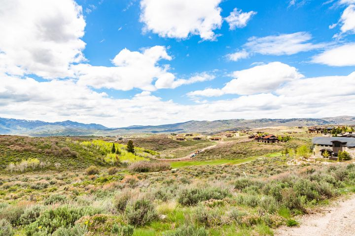 Own a piece of paradise! This acre-plus homesite has mountain views and is on the 12th hole of Promontory's Pete Dye Golf course. The back nine of this course is known for its picturesque canyons, dramatic views, and sunrise and sunset deer and elk sightings. This easy build homesite, on a private cul de sac, is gently sloping, and can accommodate a home of up to 8,000 square feet. There are no time requirements to build, and no restrictions on full-time use of the property. Nearby homesites are selling between 1 and 2.5 million making this site a tremendous deal and value! Golf and Social Memberships are available via a separate transaction through the Promontory Club.