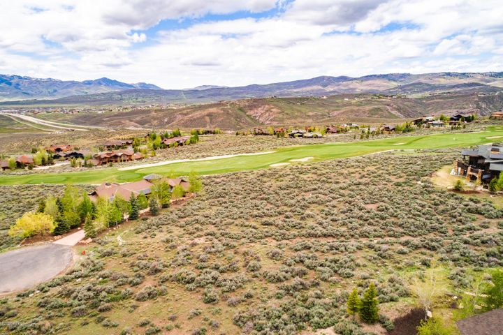 Build your dream home on this large acre+ homesite in Promontory's coveted West Hills neighborhood on the 7th hole of the award-winning Pete Dye course. Promontory is known for its amazing amenities, including Pete Dye and Jack Nicklaus Golf Courses, a Beach Club, Deer Valley and Park City Ski Lodges, hiking and bike trails, pools, and amenities for the whole family. Owners within Promontory value the views of the ski mountains, golf courses, and sunsets, and this special homesite offers a panoramic view of all three. It is also located at the end of a cul-de-sac, a short quarter-mile walk to the clubhouses. A gently sloping site with a large building envelope over 26,000 SF gives your architect a lot to work with. Membership available through a separate transaction with the Promontory Club.
