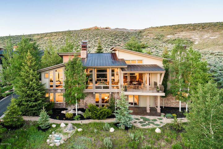 This sophisticated and refined contemporary custom home is a must-see situated on a tremendous lot in the convenient Signal Hill neighborhood. Experience sweeping, unobstructed views of Deer Valley, Park City, and the entire Wasatch Back skyline from almost every room. This stunning residence is also one of the finest landscaped properties in Promontory with gorgeous, mature evergreens that contribute to an unusually private and intimate setting. The kitchen, living, and dining rooms flow seamlessly for maximum livability and ideal entertaining. Drenched in sunlight throughout the day with drop-dead gorgeous sunset views, this home is totally stylish throughout. It's in impeccable condition inside and out with premium quality finishes, top-of-the-line appliances and ''on-trend'' modern bathrooms and kitchen. There are 5 bedrooms, 6 baths with the master bedroom and guest bedroom ensuites on the main floor, plus a spacious family room with built-ins on the lower level. The outdoor deck an d secluded, spacious rear patio includes a hot tub, fire pit, barbecue, and entertaining areas. There is also ample storage and a large 3-car heated garage. You don't want to miss this exciting, well-priced Promontory home.