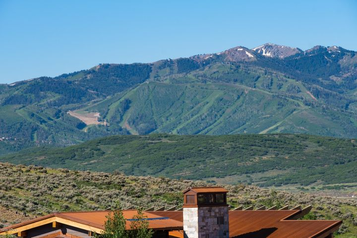 This must-see custom homesite comes with breathtaking views of Deer Valley, Park City Mountain Resort, The Canyons, and the Olympic Park. This lot offers open space to the east with easy access to the Equestrian Gate, is close to the Beach House and Tubing Hill and is located just minutes away from Park City's most acclaimed ski resorts. As a Promontory member, you'll enjoy the luxury of a convenient shuttle service to  the Promontory-exclusive Alpine Lodge at Deer Valley, or Park City Lodge at Park City Mountain Resort. Promontory is Park City's premier golf, recreational, and ski community, and is a tribute to the wide-open spaces of the West, spanning over 10 square miles. Promontory is approximately 30 minutes from the Salt Lake International Airport, allowing for easy access to this world-class destination. Club amenities are available upon acquiring a separate Club Membership. Upwall plans attached. Buyer to pay 1% community enhancement fee at Closing.