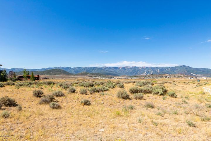 Enjoy unobstructed views to the entire Wasatch range. This flat easy build lot also enjoys quick convenient access to town via the Equestrian Gate. This .99 acre lot is the one you have been looking for. Located in the highly desirable Bison Bluffs neighborhood of Promontory and ready for your dream home. Private club membership available by separate transaction with the Promontory Club.