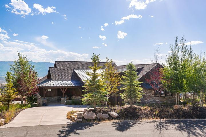 This home is elevated in Promontory with forever views to Deer Valley and Park City. This house has a light drenched kitchen, a floor-to-ceiling stone fireplace in the living room, and a covered deck with a firepit and ceiling heaters so you can enjoy it year-round. Beautiful finishes, like hardwood floors, reclaimed beams, and a flagstone patio are added touches that make this home special. A lower-level family room and well-appointed bedrooms give you plenty of space for family and friends. Offered tastefully furnished.