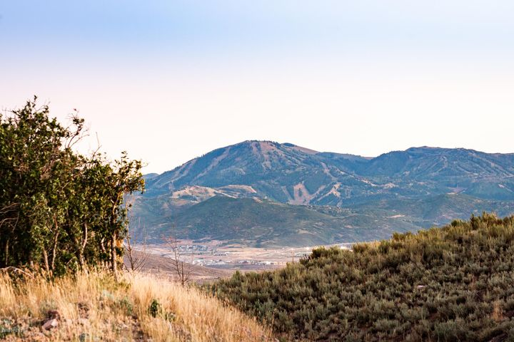 This stunning lot enjoys 360 degree views from the literally the Top of Promontory. Rockport Reservoir to the Wasatch back ski runs and everything in between are all in view from this gently sloping Lot. The 1.56 acres (allowing for a 8000 sq. foot compound) backs to 100's of acres of open space! Summit 48 is at the highest point of the entire Promontory Development, and sits tucked away with privacy and seclusion on a section of the road with only 2 other homes on it. This lot has a complete set of Approved Upwall Plans with it as well as an approved Permit (may need to be renewed) from Summit county. Come live your Dreams at the Summit of Promontory Club! Membership available by separate transaction with Promontory Club.
