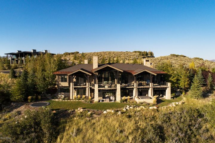 This stunning Otto Walker designed home is situated on a premier Deer Crossing Lot in Promontory. The abundance of windows showcases the breath-taking views during both sunrise and sunset framing Park City's ski resorts. This sophisticated home is equipped with convenience and luxury. Entertaining is effortless with the open floor plan, multiple gathering areas, abundance of outdoor living spaces, and an elegant atmosphere. The kitchen can accommodate a large crowd with ease. Smart finishes include a one-of-a-kind bedroom, heated motor court and patio, outdoor kids play zone, dramatic deck top fire pit, and spa. The short walking distance to the Promontory amenities completes this package, making this a must-see property for the discerning luxury homebuyer.