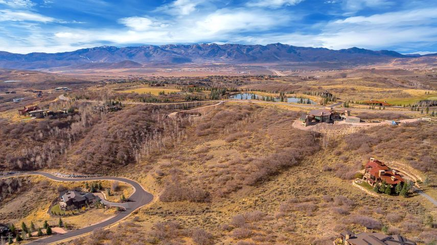 This 1.65 acre home site, situated in Promontory's premium Deer Crossing neighborhood, captures beautiful Uintah Mountain views and ambience. This uphill lot provides for a variety of luxury home designs up to 8,000 sq ft. This lot is situated just a short distance to the amenities compound. The Promontory Ranch Club is an exclusive multi-generational community. Its club membership boasts outstanding amenities for all ages, all seasons and all outdoor interests. The amenities include two signature golf courses (Pete Dye and Jack Nicklaus), workout facilities, a spa, heated pools, tennis courts, ice skating rink, a trail system, an equestrian center, a dedicated kid's cabin. Plus another family center (The Shed) with bowling, a movie theater, and amphitheater. And recently added Beach Club including wading pool, paddle boards, caf and second amphitheater. This world class development is only minutes to Park City and its renowned skiing, shopping, and restaurants.