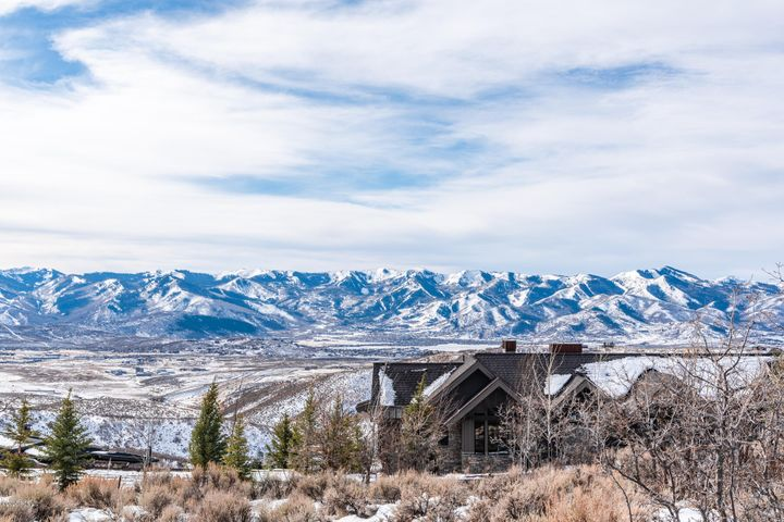 This two-acre homesite offers beautiful views in a very private setting. Located in the esteemed Promontory community, this location is just minutes from Main Street and Park City's acclaimed ski resorts. The elevated building envelope allows for a 3,500-8,000 sq. foot residence with sweeping views of the ski resorts, natural rock formations, and Lewis Peak to the north. The HOA provides a ski shuttle service to Park City Mountain and Deer Valley Resort, 30+ miles of hiking and biking trails, a park with a soccer field, sand volleyball and basketball court, stocked fishing pond, annual 4th of July party, sandy beach with fire pits, stand-up paddle boarding and kayaking, dog park, bocce ball, amphitheater tubing hill, and more! Additional amenities such as golf, swimming pools, clubhouses, etc. are available through optional club membership with Promontory Club.
