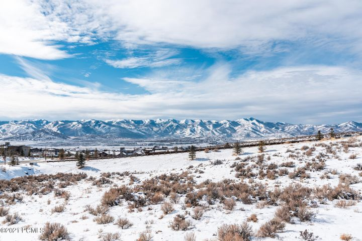 This stunning lot enjoys wonderful west views to the Wasatch back ski runs while sitting on gently sloped land that begs for an outdoor fire-pit. Next to the coveted Painted Sky area, this 1.22-acre gem allows for an 8000 sq. foot home. Backs to two sides of open space and a trail system that will take you to oodles of clubhouse amenities! Your home will be totally secluded with a $25,000.00 tree/landscape package provided by the seller to ensure total privacy and seclusion while still having a short drive to the west entrance of Promontory. Come live your dreams at one of Park City's finest gated golf communities and enjoy the Promontory Club experience! Membership available upon separate transaction with Promontory Club.