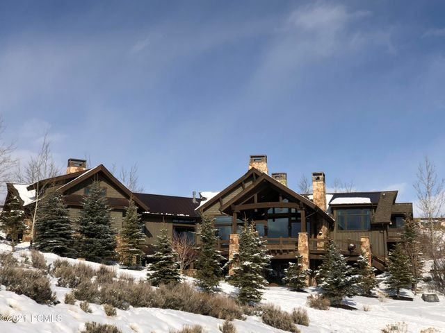 This magnificent 6,522 sq-ft custom home sits on a beautifully-landscaped 1.84-acre estate lot with dozens of mature trees, in the gated community of Promontory.  Deer Crossing subdivision in Upper Promontory.  VIEWS: Savvy buyers will immediately recognize the value of the all-day stunning views of Park City & Deer Valley ski runs and the Uinta mountains.  Remodeled in 2017.  Also available with this home is a transferable, Golf membership Reservation which can be applied at closing towards a Golf membership or maintained as a future option.  (See Additional Information.)This immaculate home has an open floor plan with 5 bedrooms, 6 bathrooms, and is ideal for entertaining.  Two laundry areas.  Large main-floor deck with access to lower level.  A large steam shower with changing area provides access to the private outdoor hot tub and fire pit.  The expansive kitchen - any chef's dream - boasts Sub Zero 36'' fridge, 36'' freezer, Wolf range, double ovens, warming drawer, two islands, and hand-scraped walnut floors.  Winter warmth comes from luxurious radiant-heat flooring.  Lower-level Mini Bar.  Control(4) system offers programming for Media, Security, Outside Lighting, and Rooftop Heat Strips.Promontory is a four-season community.  All Promontory owners enjoy world-class amenities such as Saddle Lake, Saddle Lake Tubing Hill, Saddle Lake Park, Shuttle to ski areas, Mountain Garden Park & Pond, Boat House, and miles of trails.  Access to Promontory's golf courses, restaurants, equestrian center, tennis courts, swimming pools, kids cabin, and more are available with Club Memberships.  LOCATION: Short walk to the Driving Range, Main Clubhouse, Mailroom, Mountain Garden Park, and the Pond.  The adjacent 5 acres (to the south and west) are Common Area where no homes will be built.  FURNISHED.  Exceptions: Loft computer, WiFi Routers, and personal items in lower-level hallway bedroom closet.