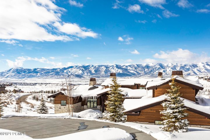 Enjoy amazing, completely unobstructed views of all 9,500 acres of Deer Valley and Park City Mountain Resort from this nearly completed home located amongst the highest elevations in Promontory, Park City's premiere club community. Unique ceiling beams, and fresh, contemporary finishes beautifully combine comfort, elegance, and style. The generous open living area on the main level opens to almost 1,000 sq. feet of covered deck space, making this home perfect for entertaining friends and family. Seven bedrooms with multiple living areas ensure that everyone has their own private space. These views are so hard to get right now - don't miss out on this amazing mountain home opportunity!
