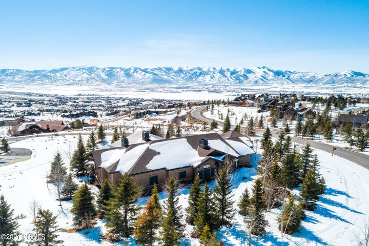 This stunning, one-owner custom home is perched at the top of the Painted Sky neighborhood with panoramic mountain views. It is just steps from Promontory's clubhouses, including the Pete Dye Golf Clubhouse, the spa, fitness center, and everyone's favorite clubhouse, the Shed. This meticulously built and kept home has an impressive floor-to-ceiling fireplace in the great room, and a kitchen any home chef would love, with a large island, built-in bar, and four dishwashers for effortless entertaining. The lower level has the same incredible views with a generous family room, a billiards room, wet bar, and climate-controlled wine room. Two main-level master suites and three additional lower-level ensuite rooms ensure your guests and family are comfortable. Two firepits, a large deck and patio, a hot tub, bocce ball court, and outdoor kitchen make the most of apres-ski and cool summer evenings. 24-hour notice required for all showings. Offered furnished.