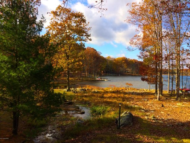 Home on two ponds and lake with the option of an additional nearly 3/4 of an acre lakefront parcel!