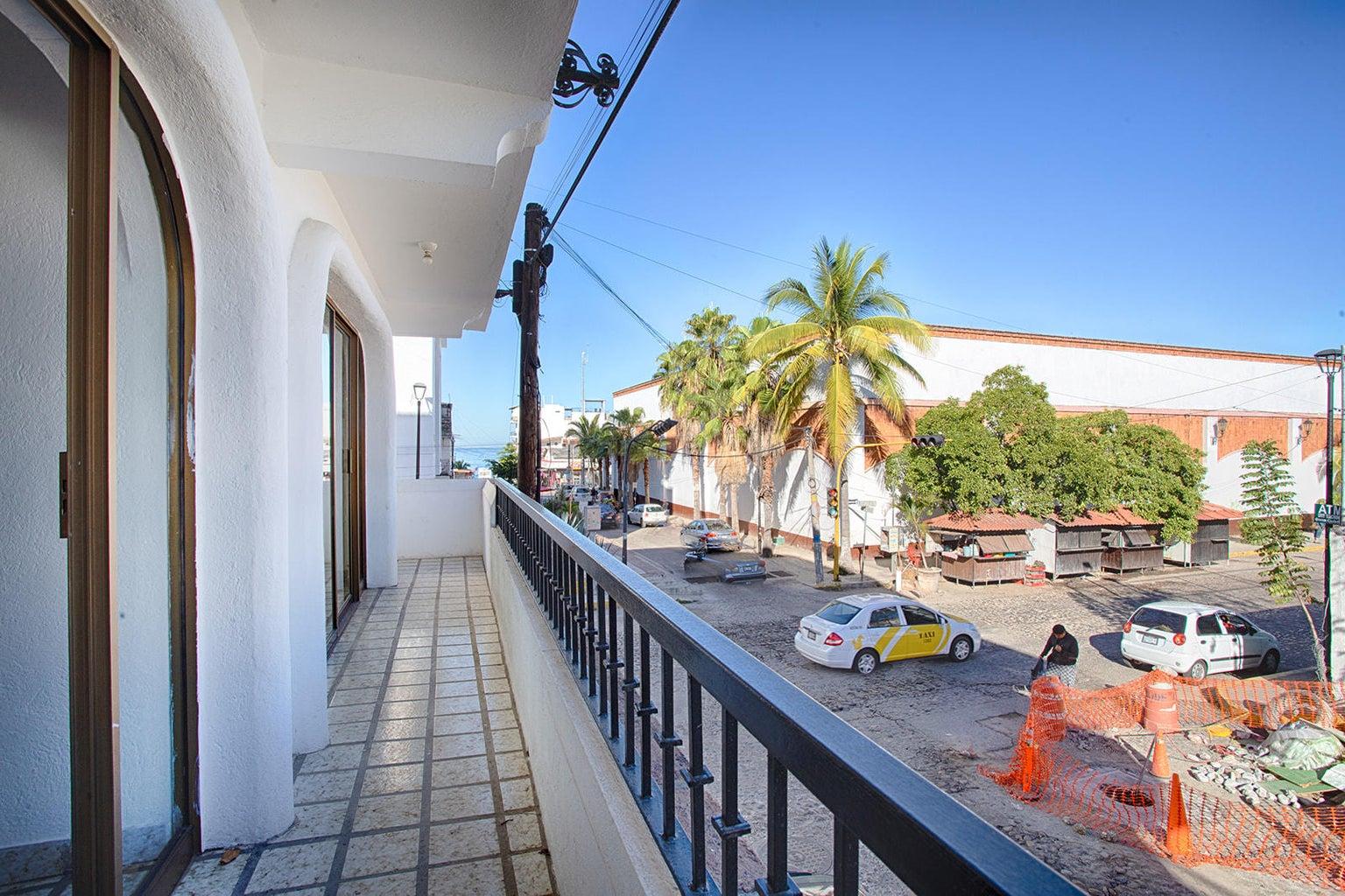 Wrap around balcony with partial ocean v