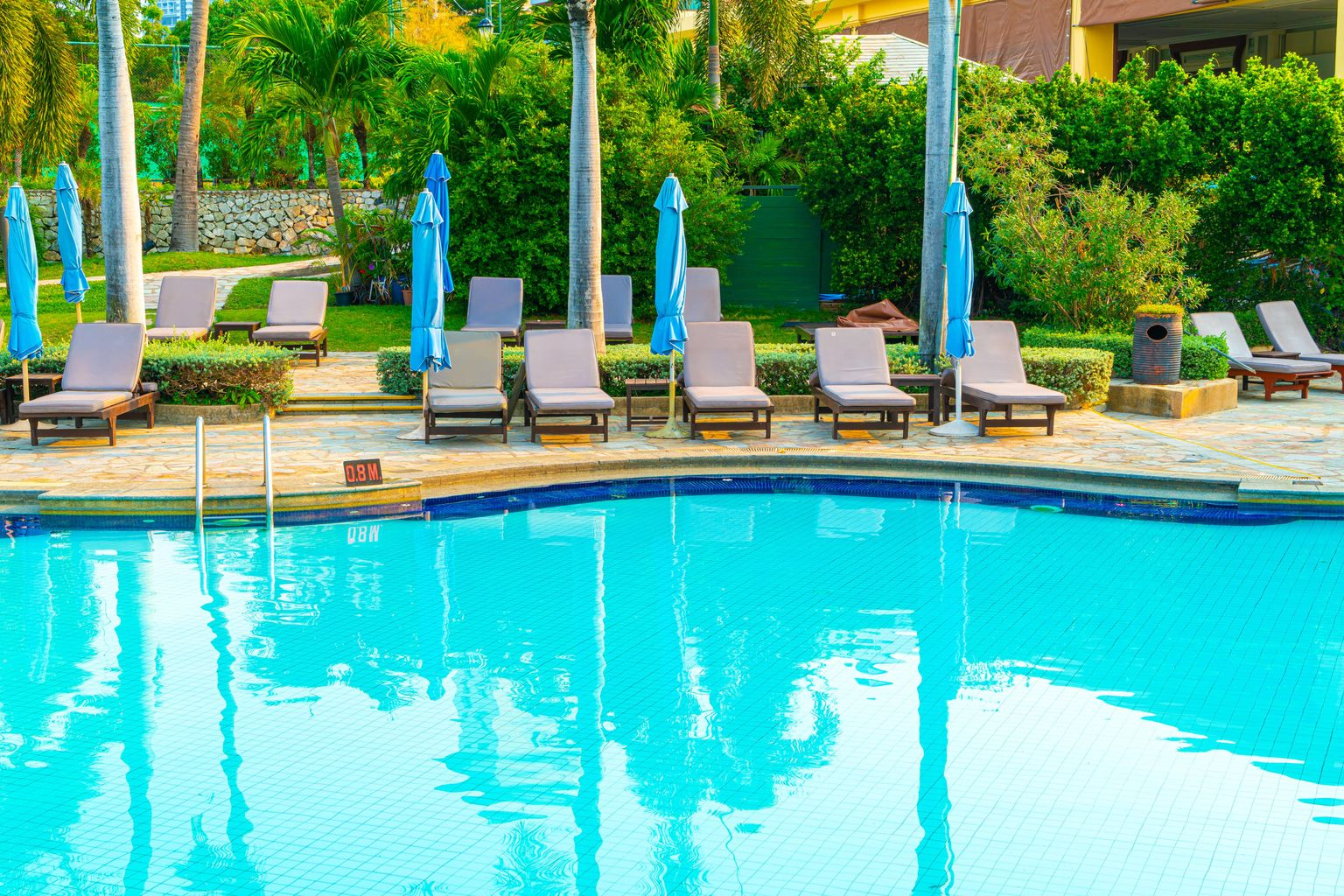 chair-pool-and-umbrella-around-swimming-