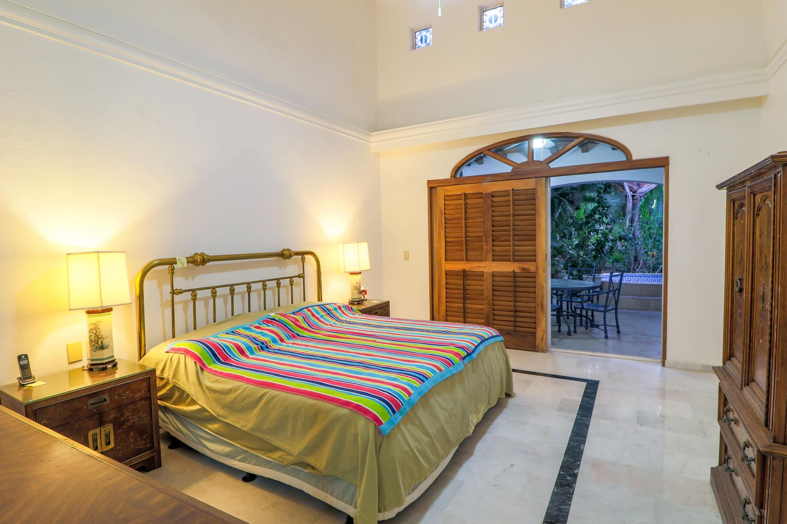 master bedroom on first floor, access to terrace and pool