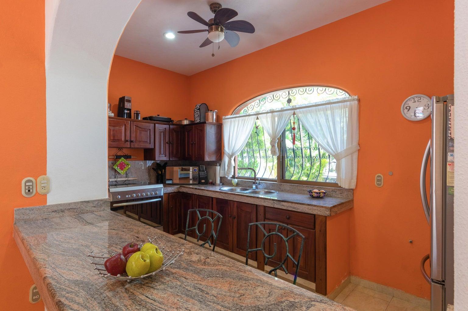 Kitchen granite and parota