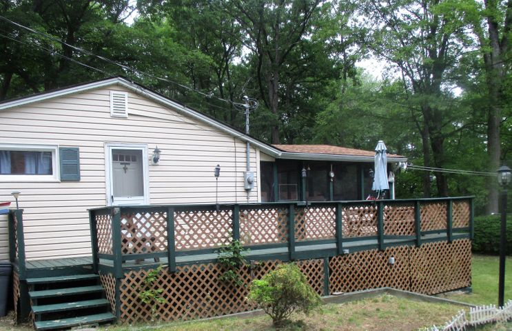 One level living ranch home with large enclosed screened in porch!