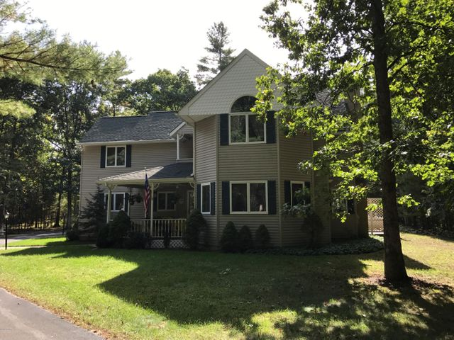 Charming, secluded home surrounded by private wooded parcel
