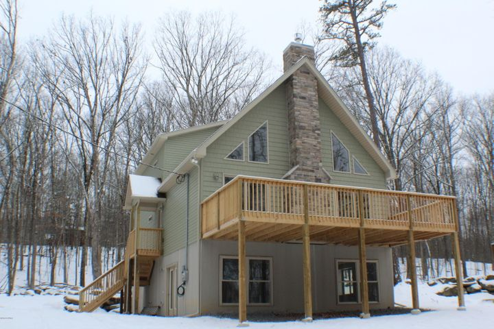 Two story home with fully finished family room, bath, and laundry area in the basement.