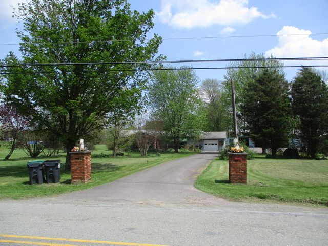 2 Master Suites! Total 4 Bedrooms 3 Baths, Attached Garage, 4 Detached Garages, Barn, Pond on 4.16 Acres.