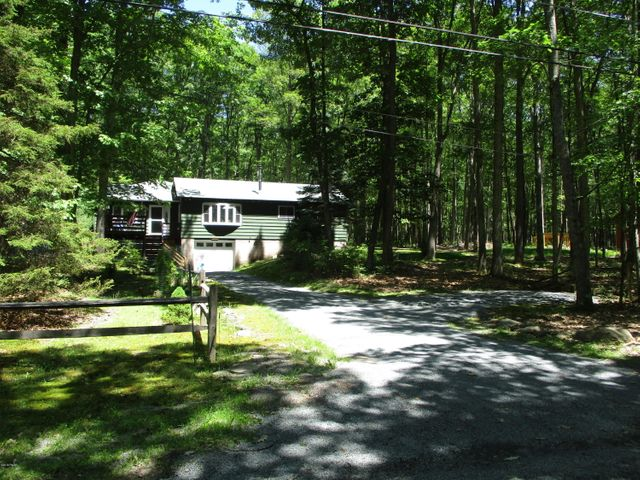 3 Bedrooms, 2 Full Baths, Garage, & DOCK on Lake.