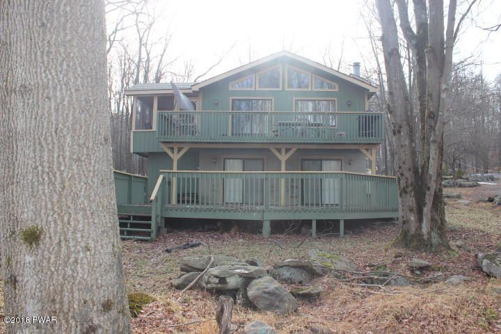 Home facing the Golf Course with two decks. Lower deck is HUGE!!