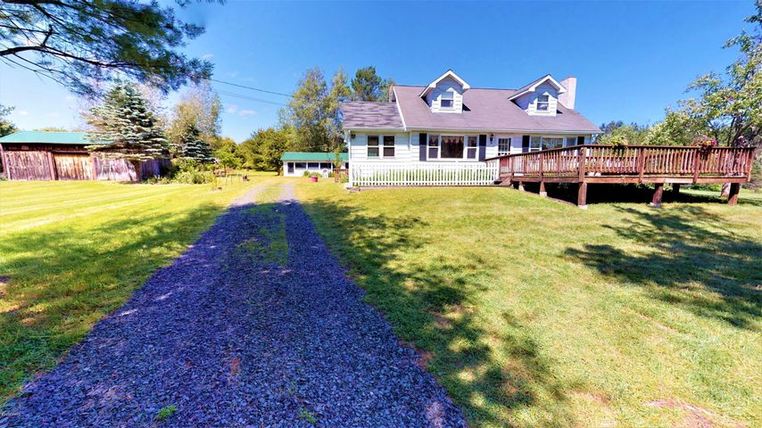 Long private driveway leads to this private estate on 16.47 sreamfront front acres with 2 houses, 2800 sq ft workshop/8 car garage and a barn