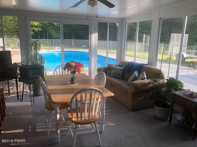 Have Your Morning Coffee in the Sun Room by the Pool