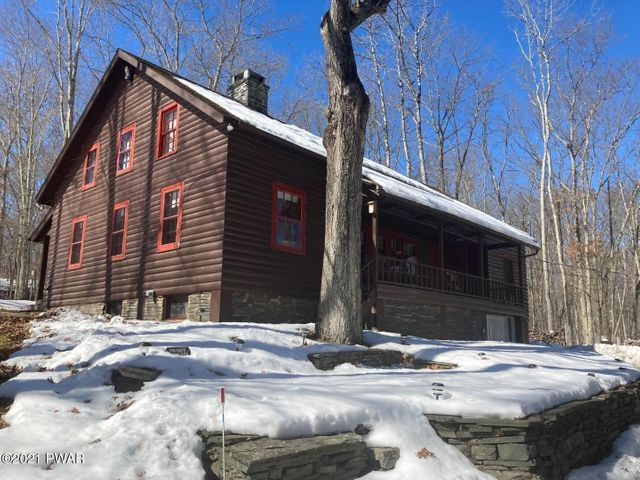 LOG HOME ON 1.85 ACRES