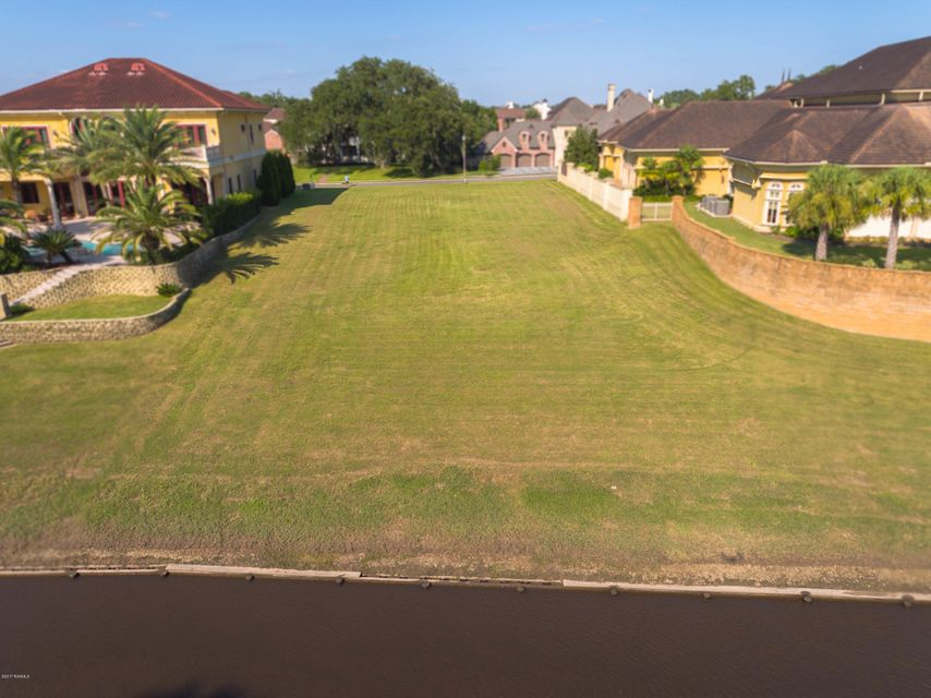 Remarkable river lot amid the most beautiful estate homes in the Edgewood neighborhood of River Ranch The bulkhead is in place and the lot is ready for construction. Square Footage is 27,180