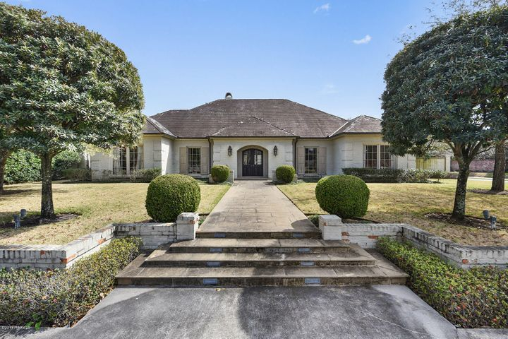 Stately brick home on one of the most desired streets in Lafayette.
