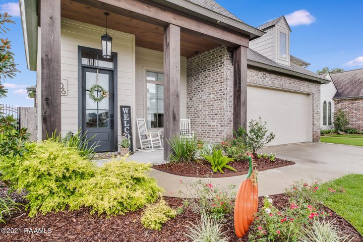 Welcome home to 106 Italian Cypress Drive in the well sought after Cypress Gardens.