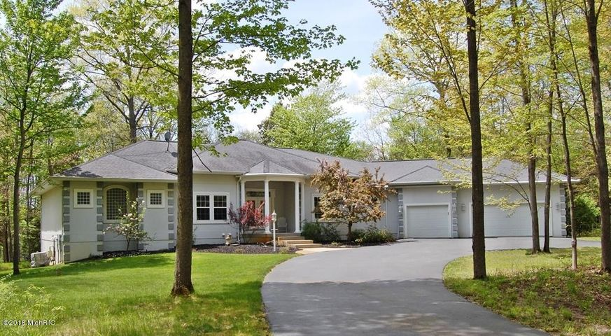 Lovely home, with circular drive, sits on a double lot that is truly lovely!