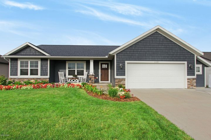 WELCOME HOME TO THIS TURN KEY WALKOUT RANCH HOME