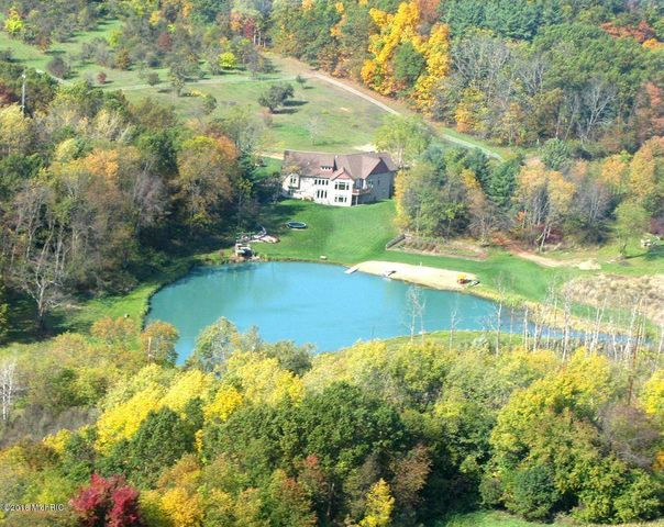 Custom home on 42 acres with pond