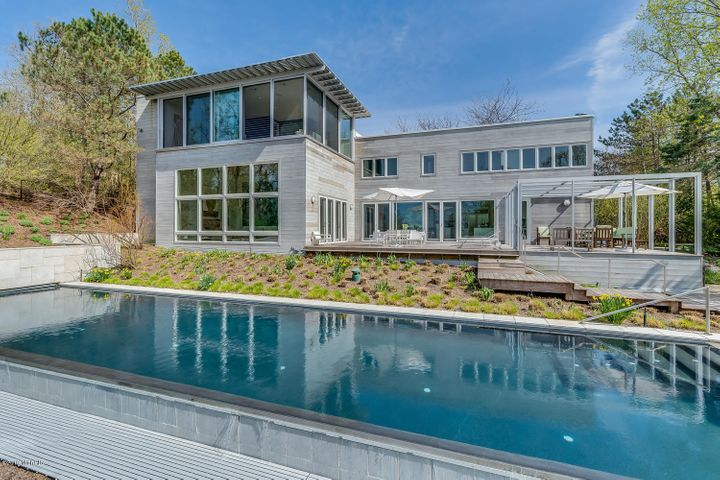 Classic Contemporary Home with an Infinity Pool overlooking Lake Michigan.