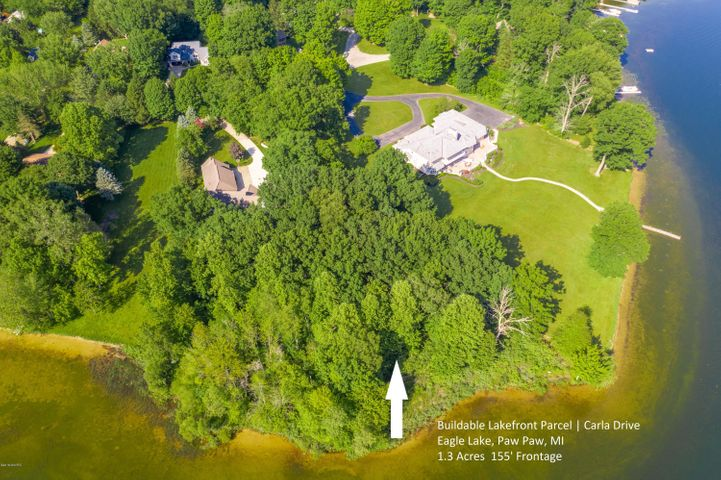 Set between million dollar homes, this beautiful lakefront lot offers 1.3 acres and 155' of sandy frontage for your custom built home.