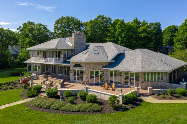WELCOME! We are pleased to present 43535 Carla Drive on Eagle Lake in Paw Paw, MI.