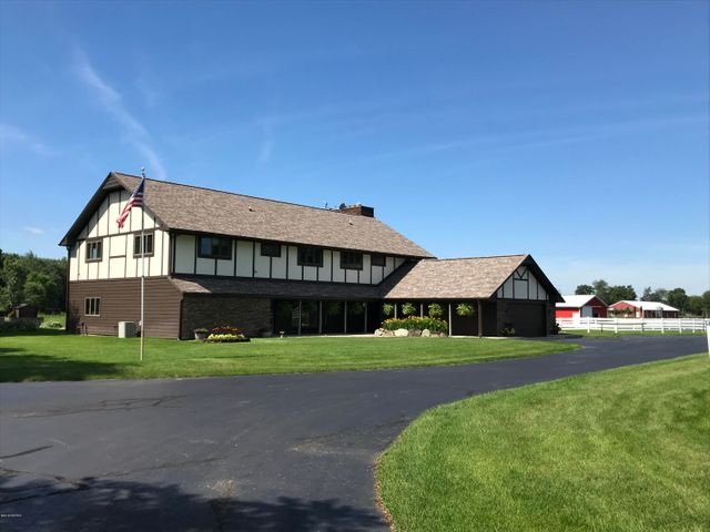51704 US Hwy 131 - Comfortably composed 5-bed, 4.5 bath Tudor on 40 beautiful acres in Three Rivers, MI