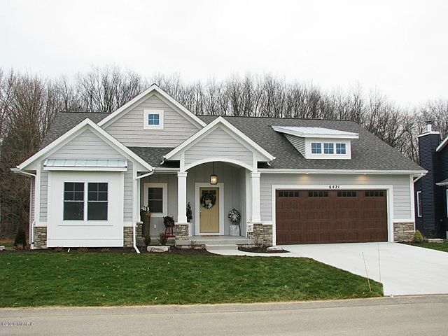 Beautiful Laketown Crossings Free-Standing model home for sale. Come see all the exciting features included in this trendy home. Enjoy views of nature and the pond from your back covered deck.