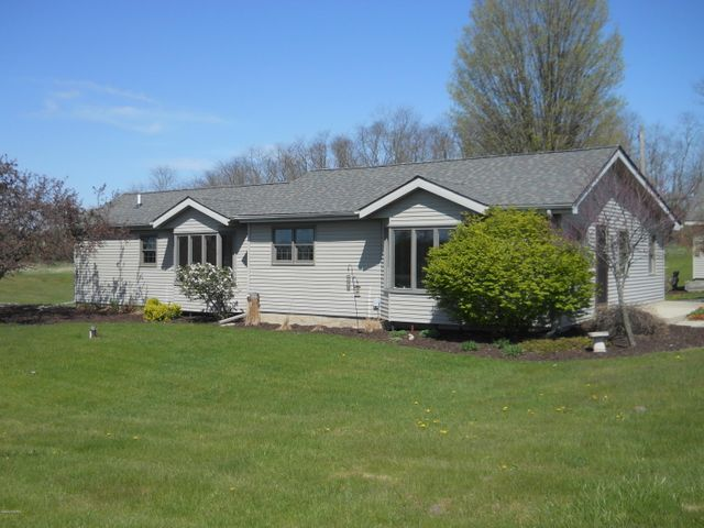 Totally transformed ranch on 6.83 acres on the corner of Lincoln Lake Rd. & Strotheide. Easy commute to Rockford, Grand Rapids, or Lowell.